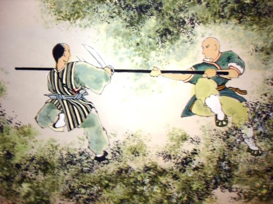 Peinture ancienne avec un baton long et des doubles couteaux